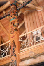 Upper portion ofTotem Pole used as a support in a log home